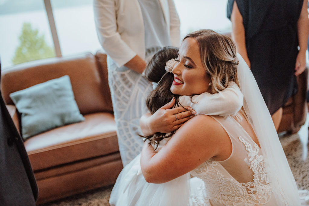 Angela+Vaughan Benedetti Wedding Dress Hugging Child