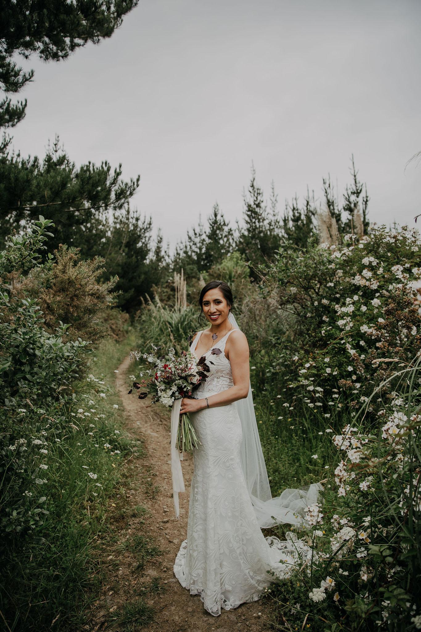 Elyssa Taulapiu Hera Bosset Gown Green And White Outdoors