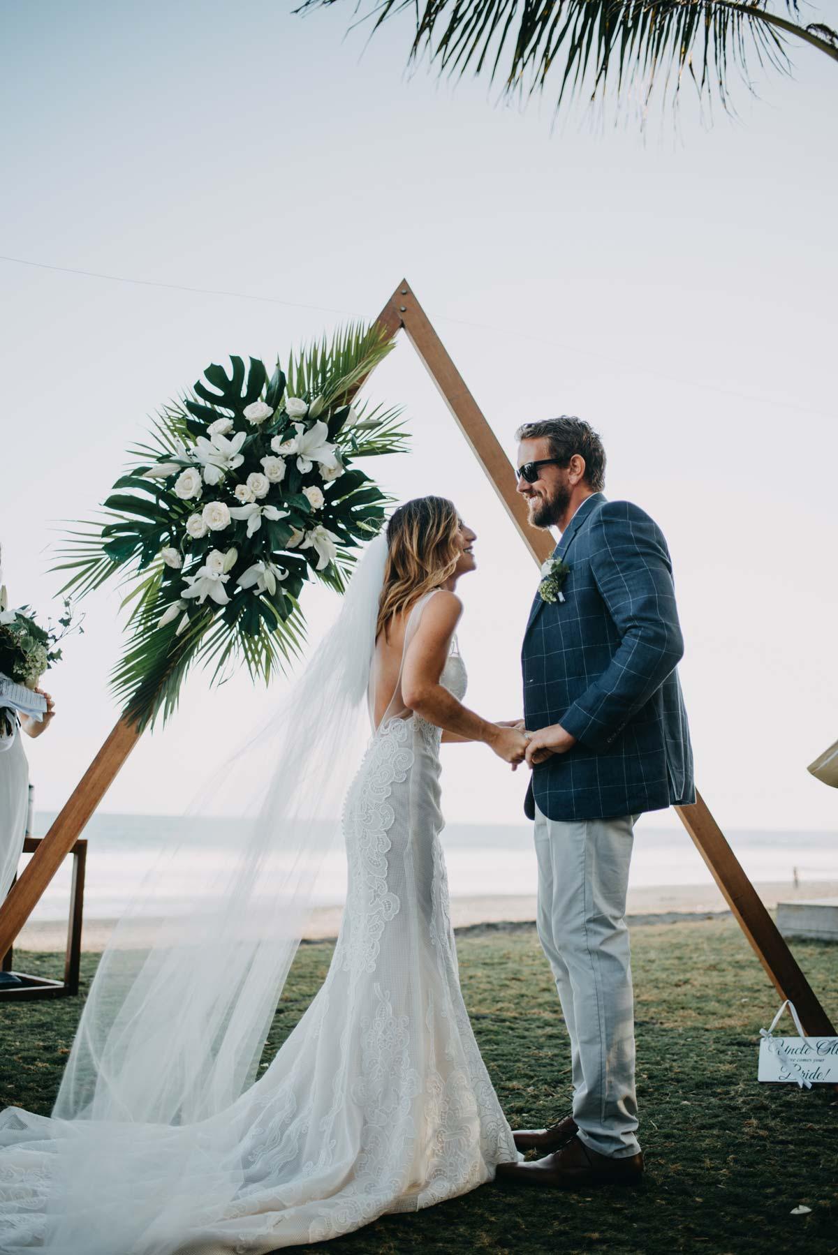 Gemma+Oli Delphinium Wedding Dress Bali Ceremony Arch Web 9496