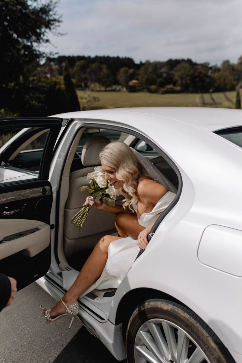 06 Bride Getting Out Of Car