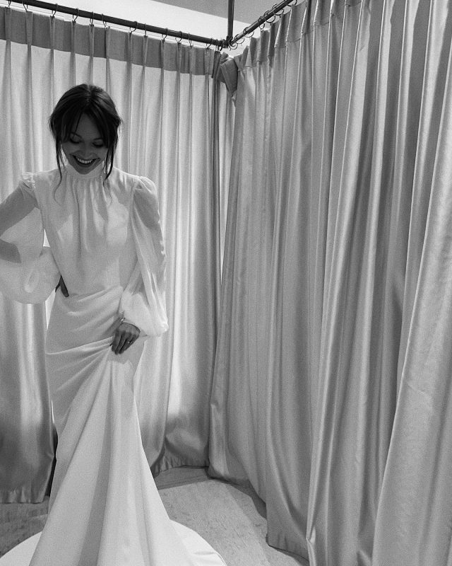 Billowing sleeves, delicate draping, and a full chapel train 🤍 Our stunning Hera bride, @rosalieburns wears GENEVA, from our latest Minimalist II Collection x