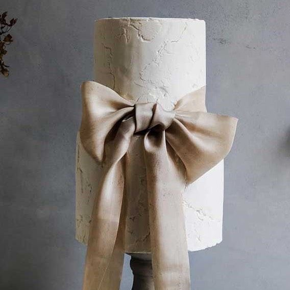 This simple, yet sophisticated sculptured cake captures the attention of the finest. 🤍  Captured via Pinterest